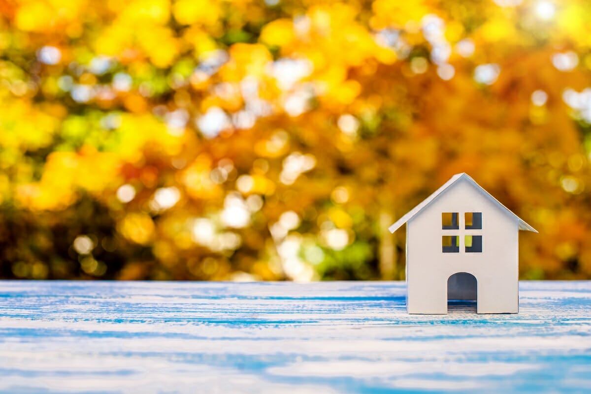 House Symbol With Autumn Leaves To Indicate Refinancing With Change Of Season